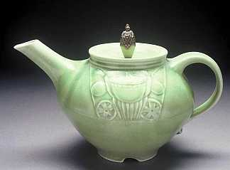 green carved teapot